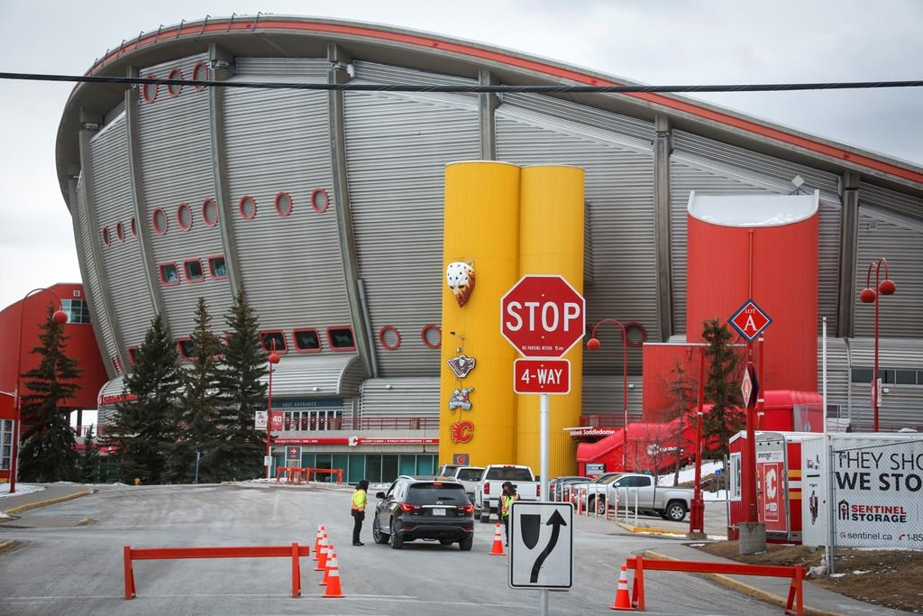 The Saddledome, home of the Calgary Flames, is seen in Calgary, Thursday, March 12, 2020.