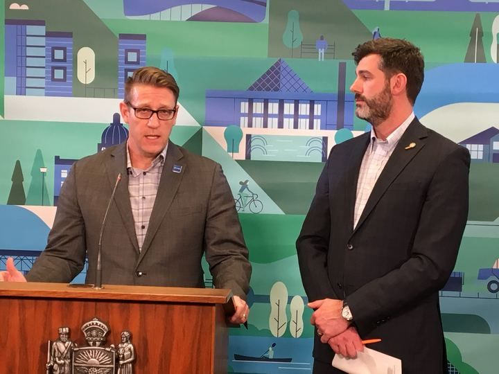 Interim city manager Adam Laughlin and Edmonton Mayor Don Iveson speak to reporters about coronavirus concerns on March 12, 2020.