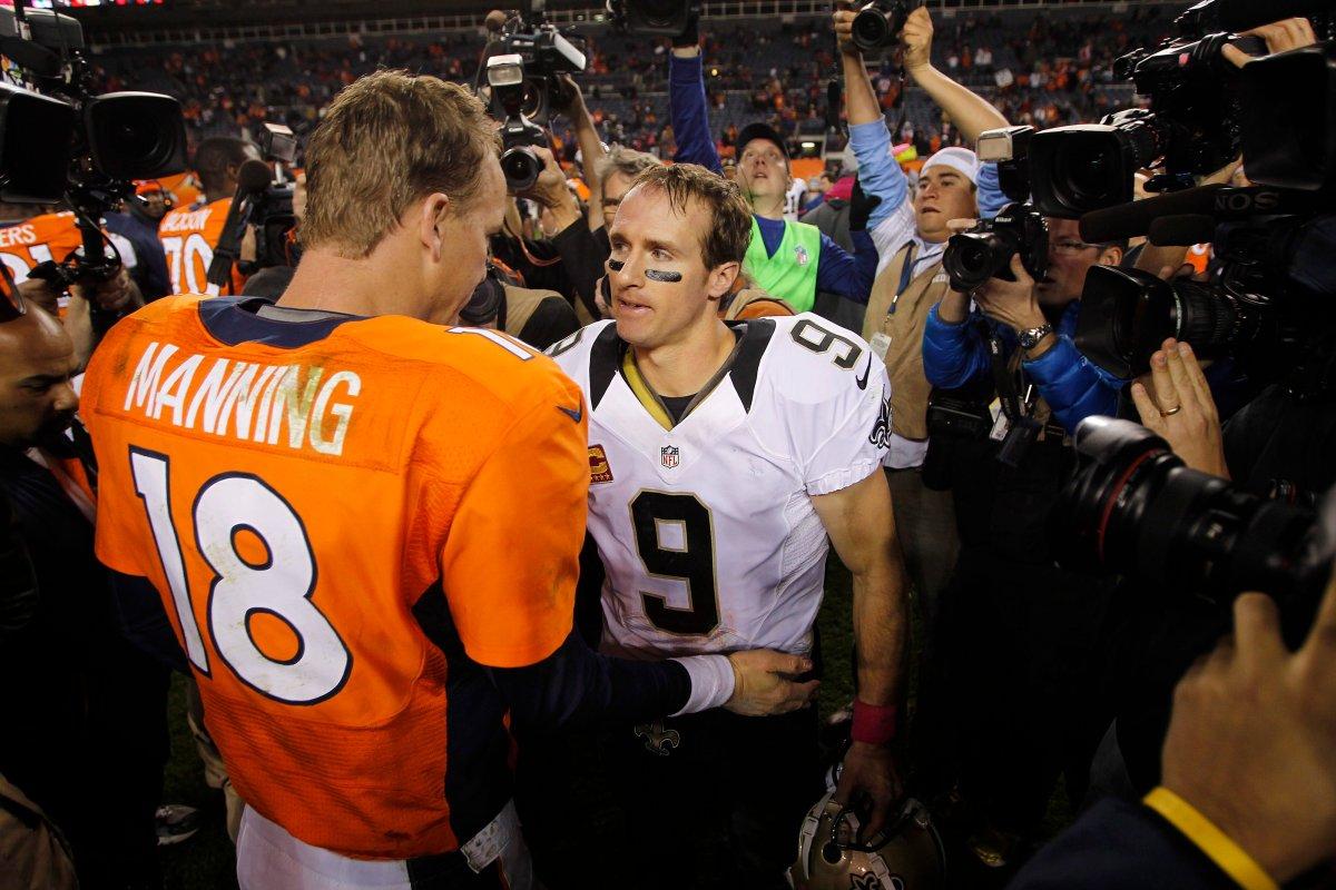 Denver Broncos quarterback Peyton Manning (18) greets New Orleans Saints quarterback Drew Brees (9) after an NFL game, Sunday, Oct. 28, 2012, in Denver.