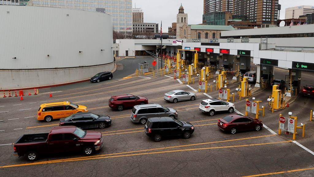 Vehicles enter the United States as a minivan drives to Canada in the Detroit-Windsor Tunnel in Detroit, Monday, March 16, 2020.