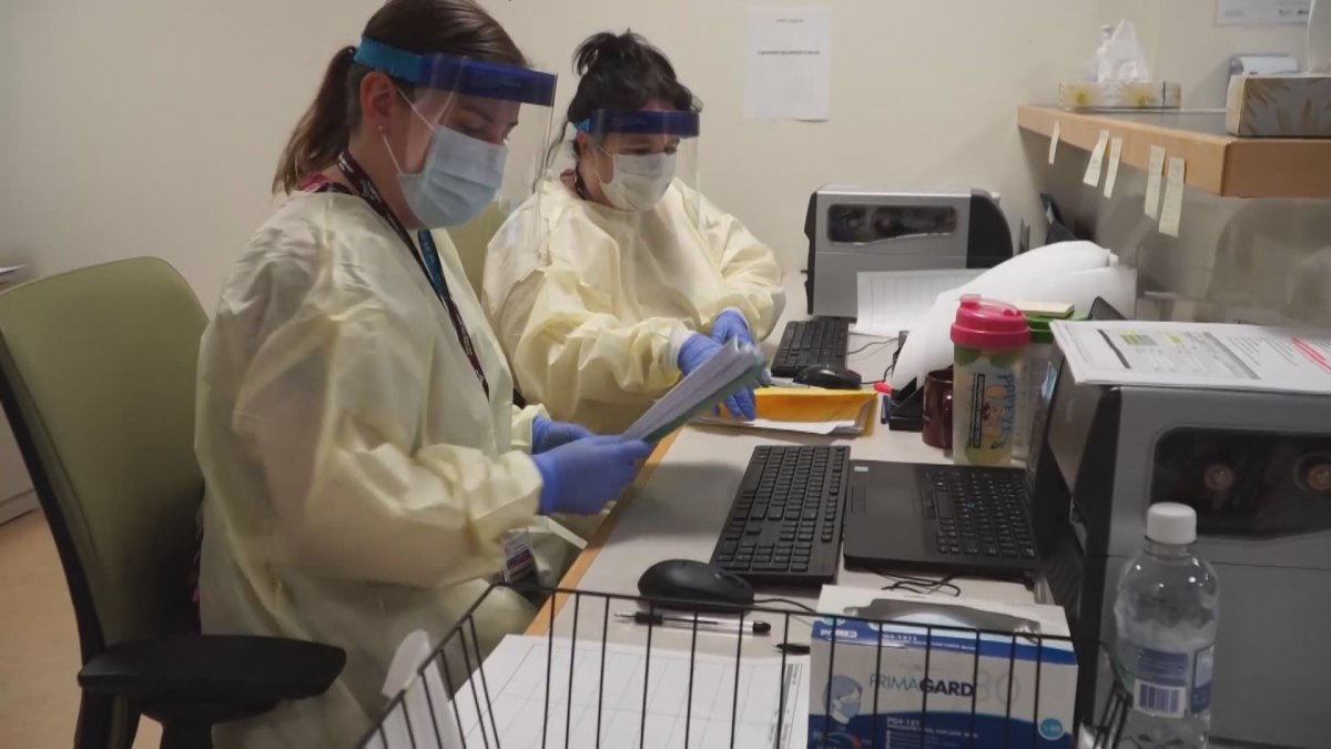 Nurses wear personal protective equipment in an Alberta hospital.