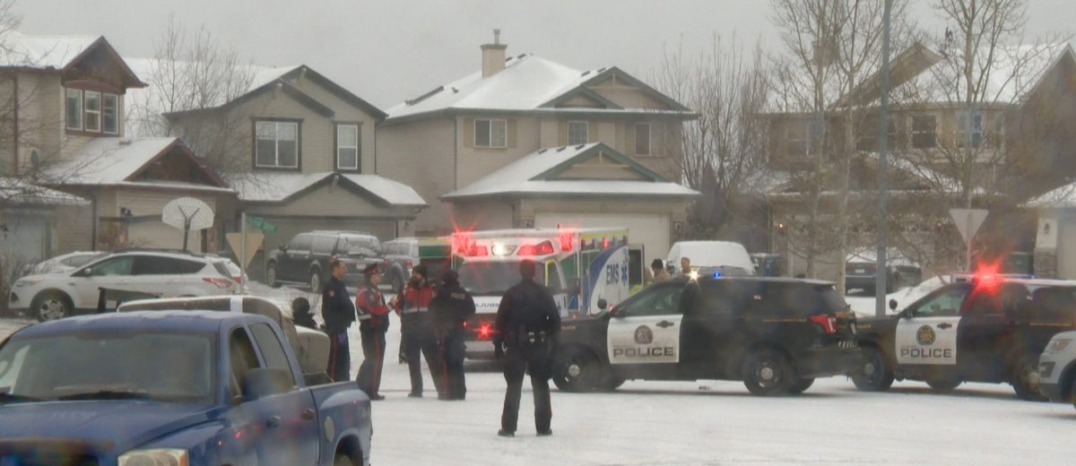 Calgary police investigate a northwest crash on Monday, March 30, 2020.