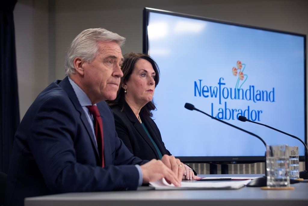 Newfoundland and Labrador Premier Dwight Ball and Natural Resources Minister Siobahn Coady release the report of the Muskrat Falls Inquiry at the Confederation Building in St. John's on Tuesday, March 10, 2020. THE CANADIAN PRESS/Paul Daly.