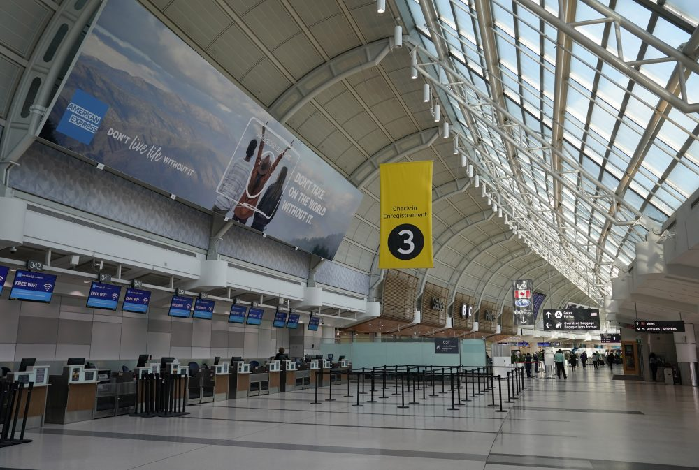 An almost-empty Terminal 3 is shown at Pearson International Airport in Toronto, Friday, March 13, 2020.