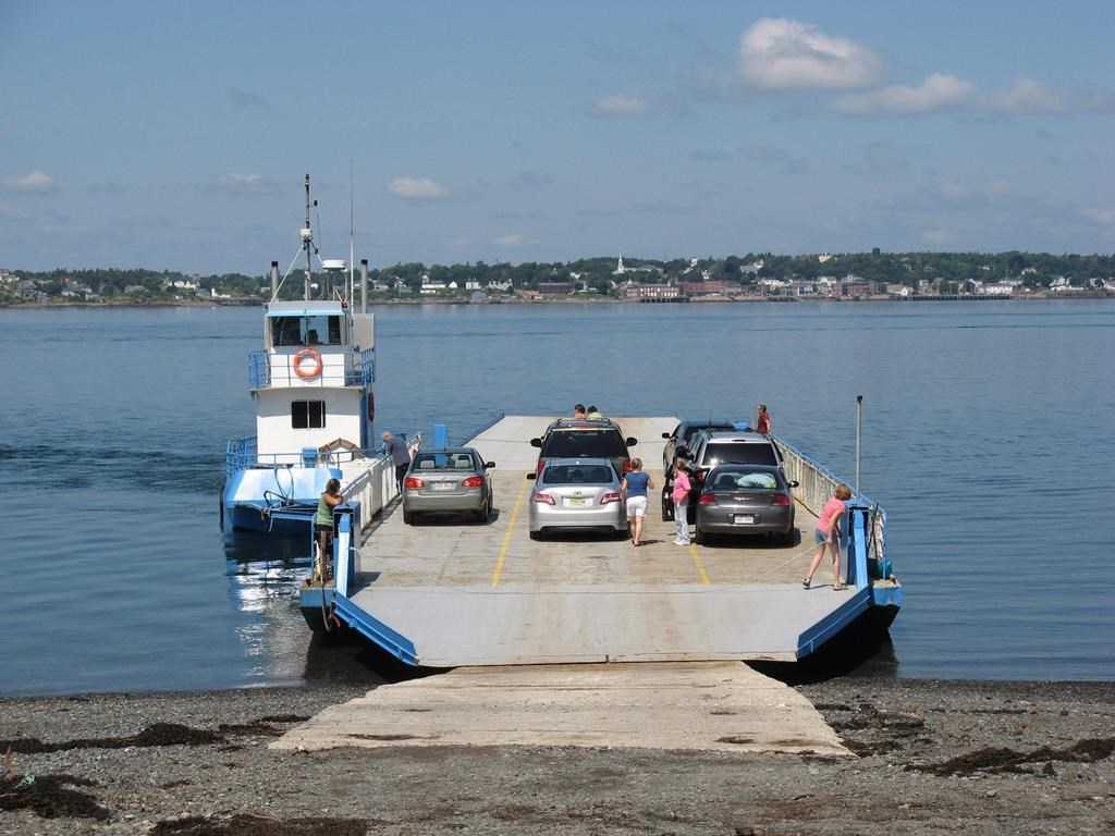 Passengers board a car ferry for the short trip from Campobello Island, N.B., to nearby Deer Island, N.B., on Aug 1, 2009.