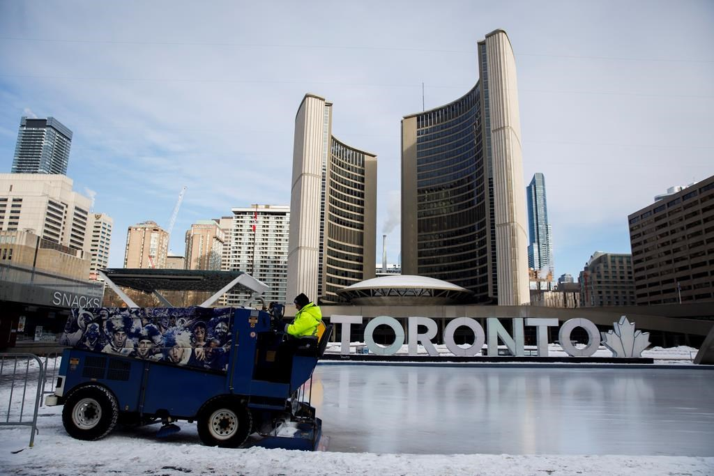 A Toronto city worker operates a Zamboni on the skating rink outside of Toronto City Hall on Saturday, Feb. 29, 2020.