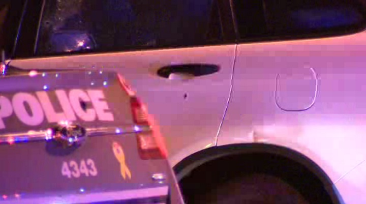 A vehicle appears to have been shot multiple times.
