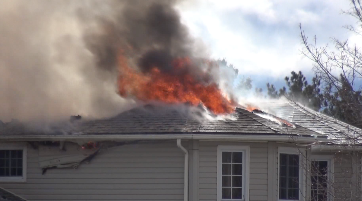 Selwyn Township fire-fighters battle a house fire on Brick Road in Ennismore on Friday morning.