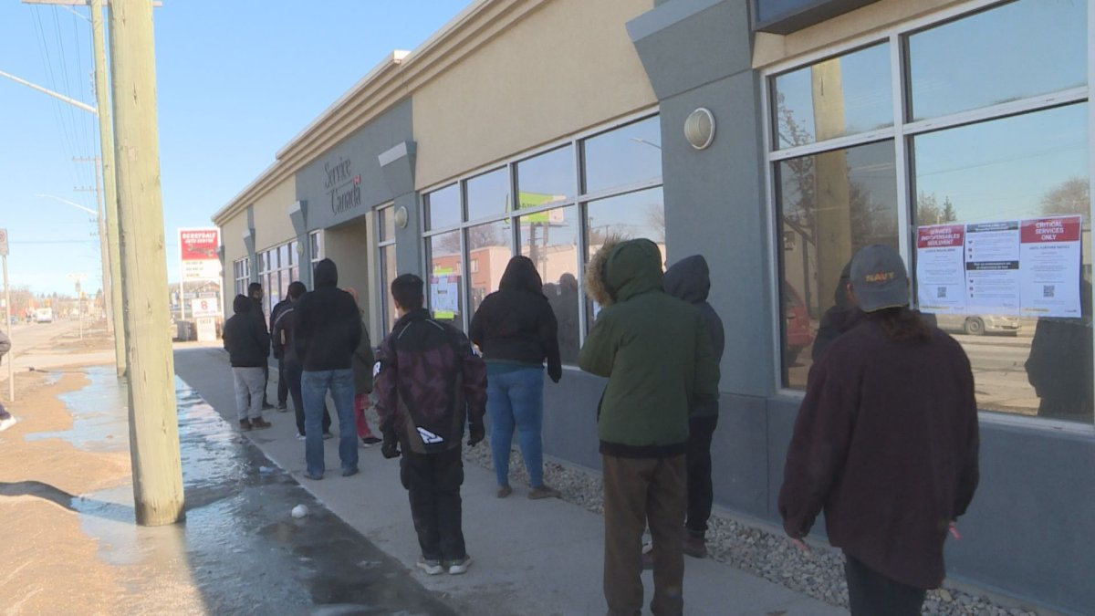 People lined up outside the Service Canada location on St. Mary's Road Wednesday morning.