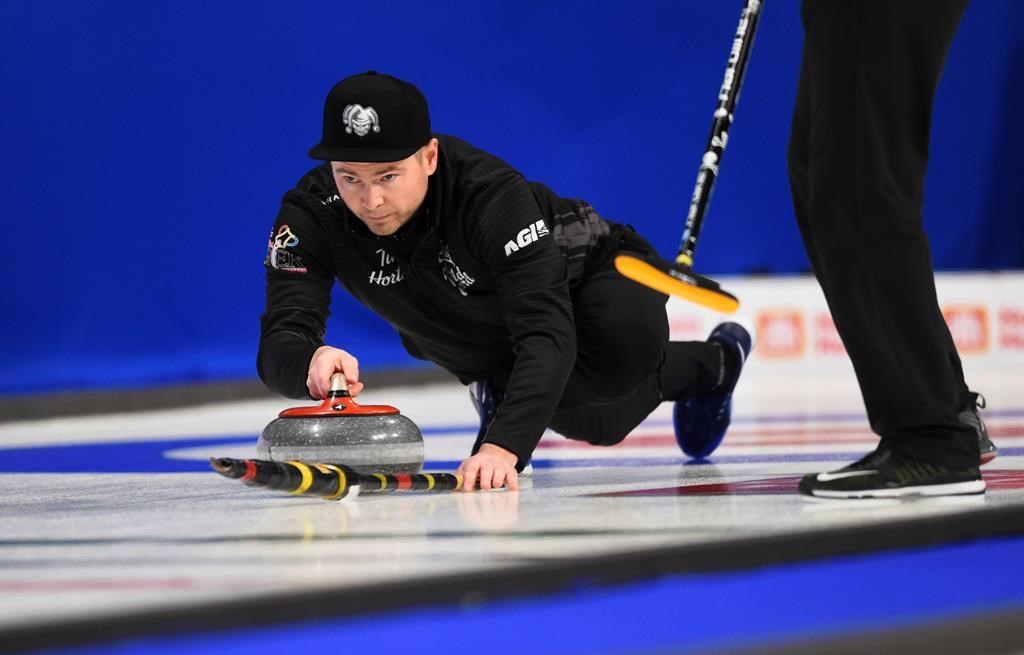Team Wild Card skip Mike McEwen throws as he takes on Team Yukon at the Brier in Kingston, Ont., on Sunday.