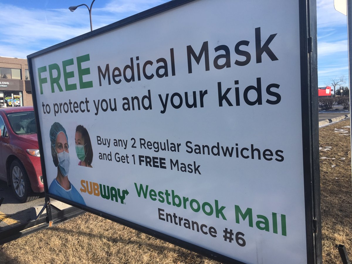 A sign outside Westbrook Mall in Calgary advertised a free medical face mask to customers who bought two sandwiches.