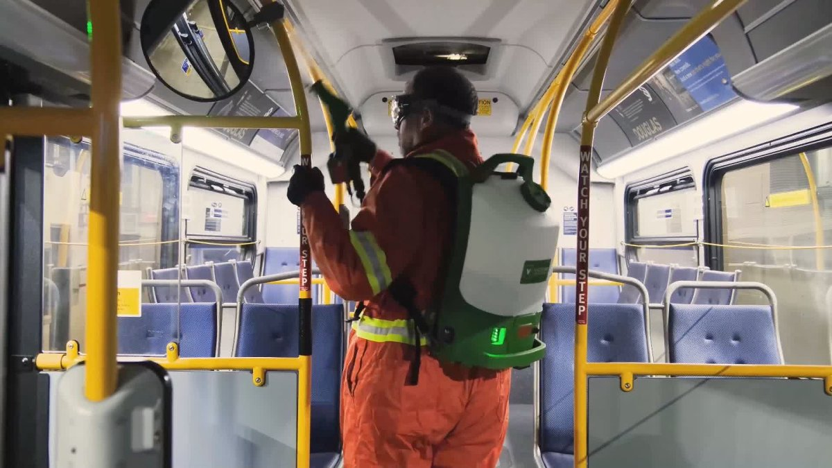 TransLink crews spray a bus with disinfectant. The transit authority says buses are now getting a weekly spray, along with regular cleaning.