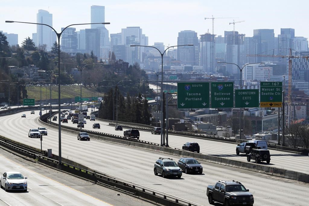 Early afternoon traffic is thin on Interstate 5 north of downtown Seattle, Friday, March 20, 2020. With many people working from home or otherwise not traveling, Seattle's notorious traffic has been minimal during the outbreak of the new coronavirus.