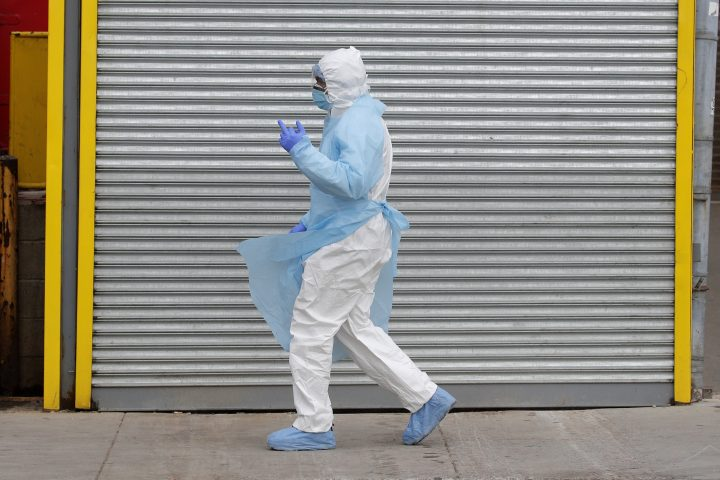 A healthcare worker walks in Personal Protective Equipment (PPE) outside Wyckoff Heights Medical Center during the outbreak of the coronavirus disease (COVID-19) in the Brooklyn borough of New York City, New York, U.S., April 2, 2020.