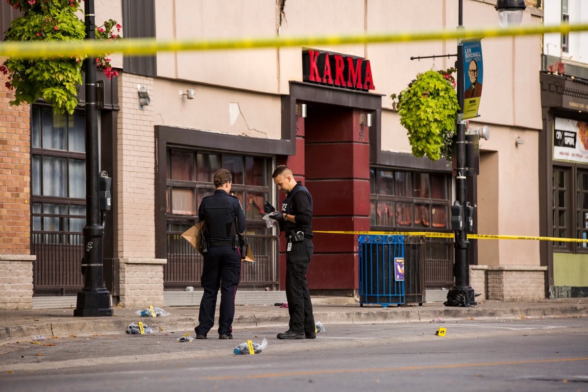 Niagara Regional Police Service officers investigate a shooting that took place early Sunday in the area of the Karma nightclub on St. Paul Street in St. Catharines, Ont., Sunday, Sept. 29, 2019.