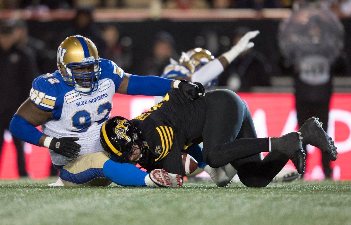Winnipeg Blue Bombers' Drake Nevis sacks Hamilton Tiger-Cats quarterback Dane Evans during the first half of the 107th Grey Cup in Calgary, Alta., Sunday, November 24, 2019.
