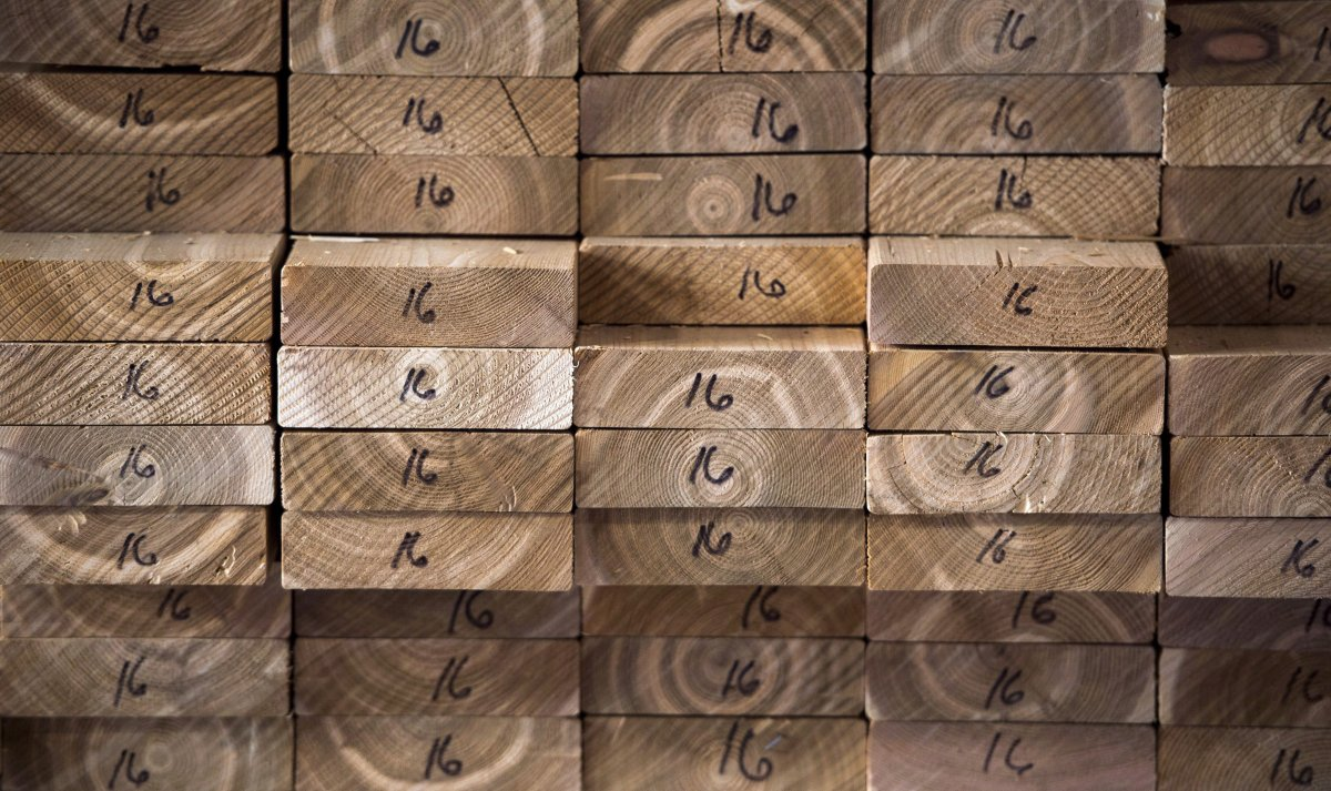 Cedar planks are stacked at a lumber yard in Montreal, Tuesday, April 25, 2017. Resolute Forest Products Inc. says it's laying off more than 1,000 people.