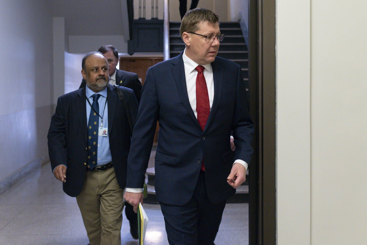 Saskatchewan Premier Scott Moe and Saqib Shahab, chief medical health officer, arrive at a COVID-19 news update at the legislative building in Regina on March 18, 2020.