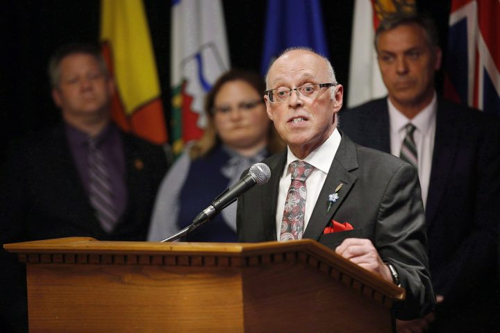 John Haggie, Newfoundland and Labrador minister of health and community services, responds to a reporter's questions at a press conference during the Conferences of Provincial-Territorial Ministers of Health in Winnipeg on June 28, 2018.