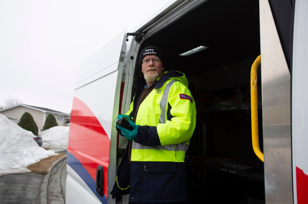 Craig Dyer, a postal worker, is back on the job delivering mail in Mount Pearl, Nfld., on Friday, April 3, 2020 following a two week isolation period when a co-worker tested positive for COVID 19.