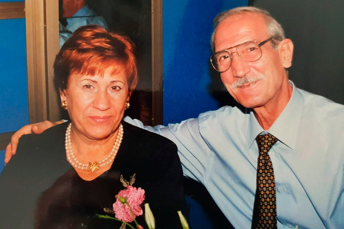 This undated photo provided by the family in April 2020 shows Enrico Giacomoni and his wife, Giulia Chiodi. The last time Roberto Giacomoni saw his 80-year-old father Enrico, he gently helped him up from bed, put his socks, shoes and jacket on, and walked him out to the paramedics who had come to take him to the hospital because he was having trouble breathing. (Courtesy of Giacomoni family via AP).