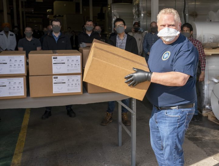 Ontario Premier Doug Ford loads ASTM Level 3 masks made by The Woodbridge Group in Woodbridge, Ont. on Tuesday, April 7, 2020.