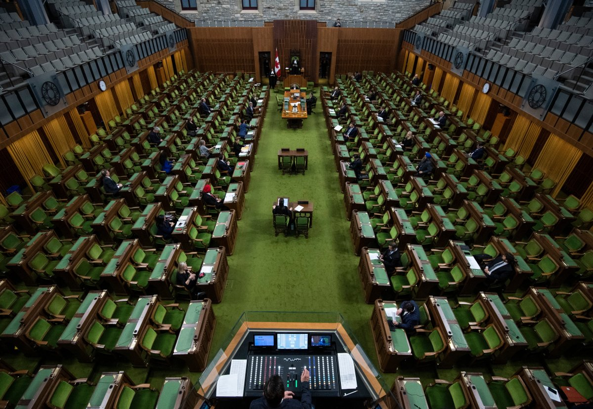Members of Parliament, attending in limited numbers and seated apart to practice physical distancing, wait for proceedings to begin in the House of Commons on Parliament Hill in Ottawa, as Parliament was recalled for the consideration of measures related to the COVID-19 pandemic, on Saturday, April 11, 2020.