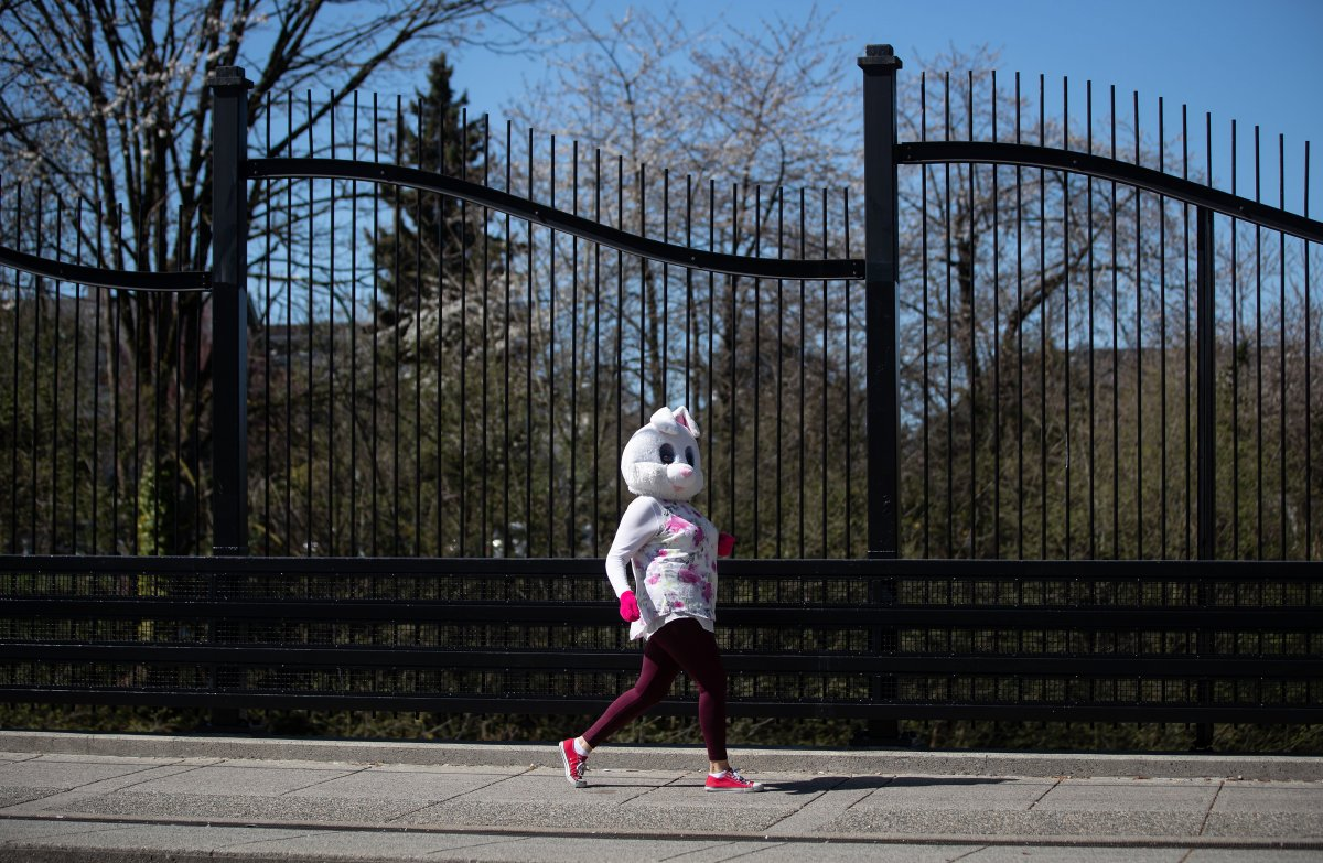 A person wearing an Easter bunny costume walks along Commercial Drive in Vancouver on Sunday, April 12, 2020.