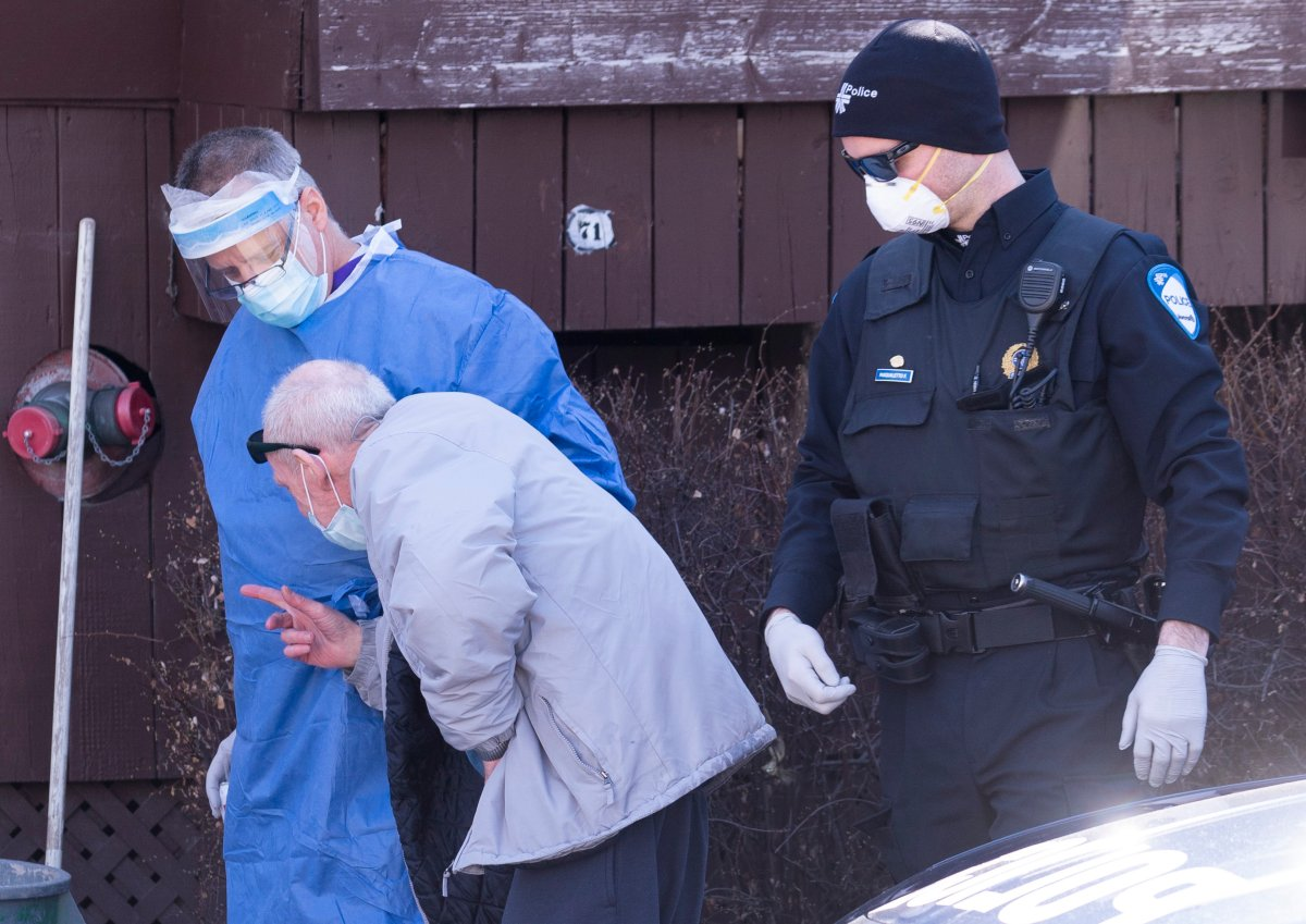 Police return a resident of the Yvon-Brunet seniors residence after having wandered away in Montreal, on Thursday, April 16, 2020.