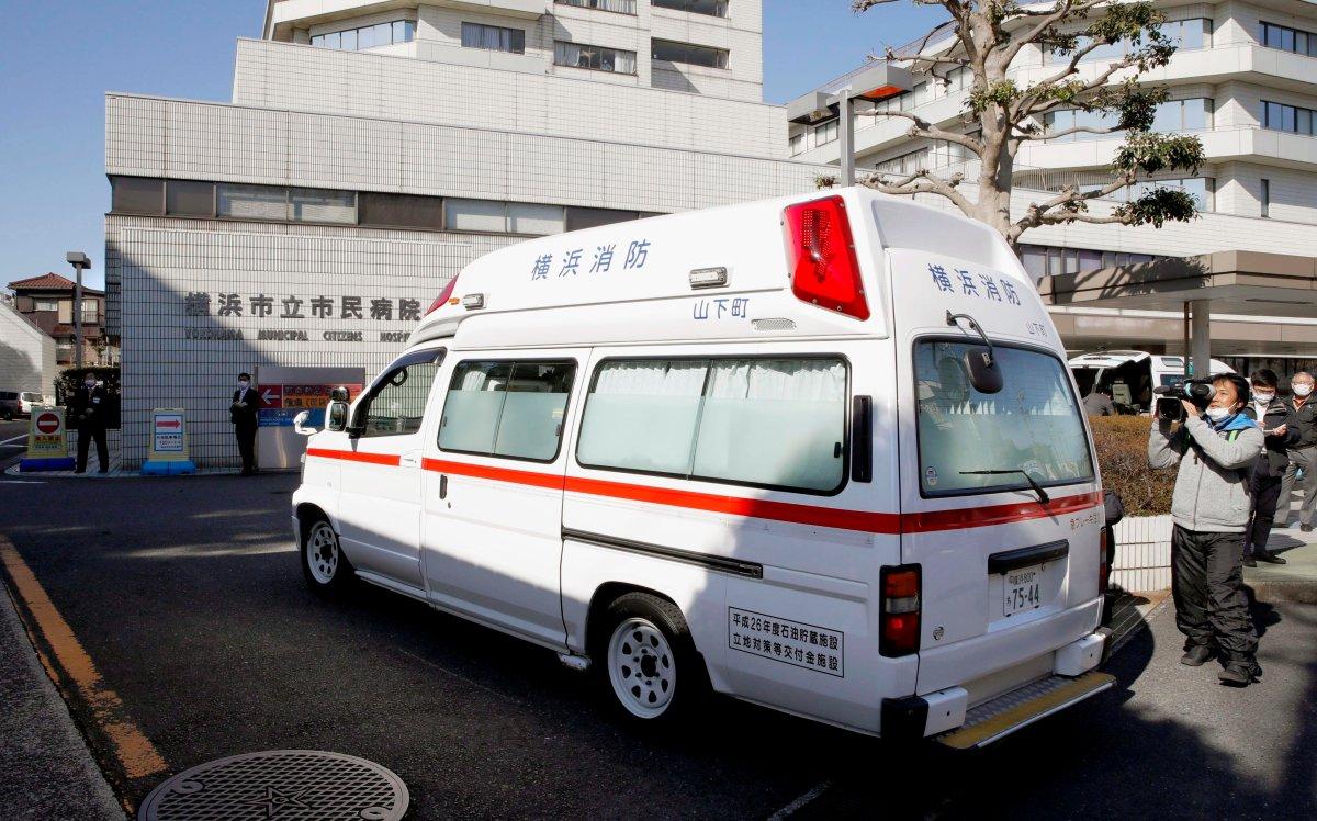 In this Feb. 5, 2020, photo, an ambulance carrying a passenger onboard cruise ship Diamond Princess arrives at a hospital in Yokohama, near Tokyo.