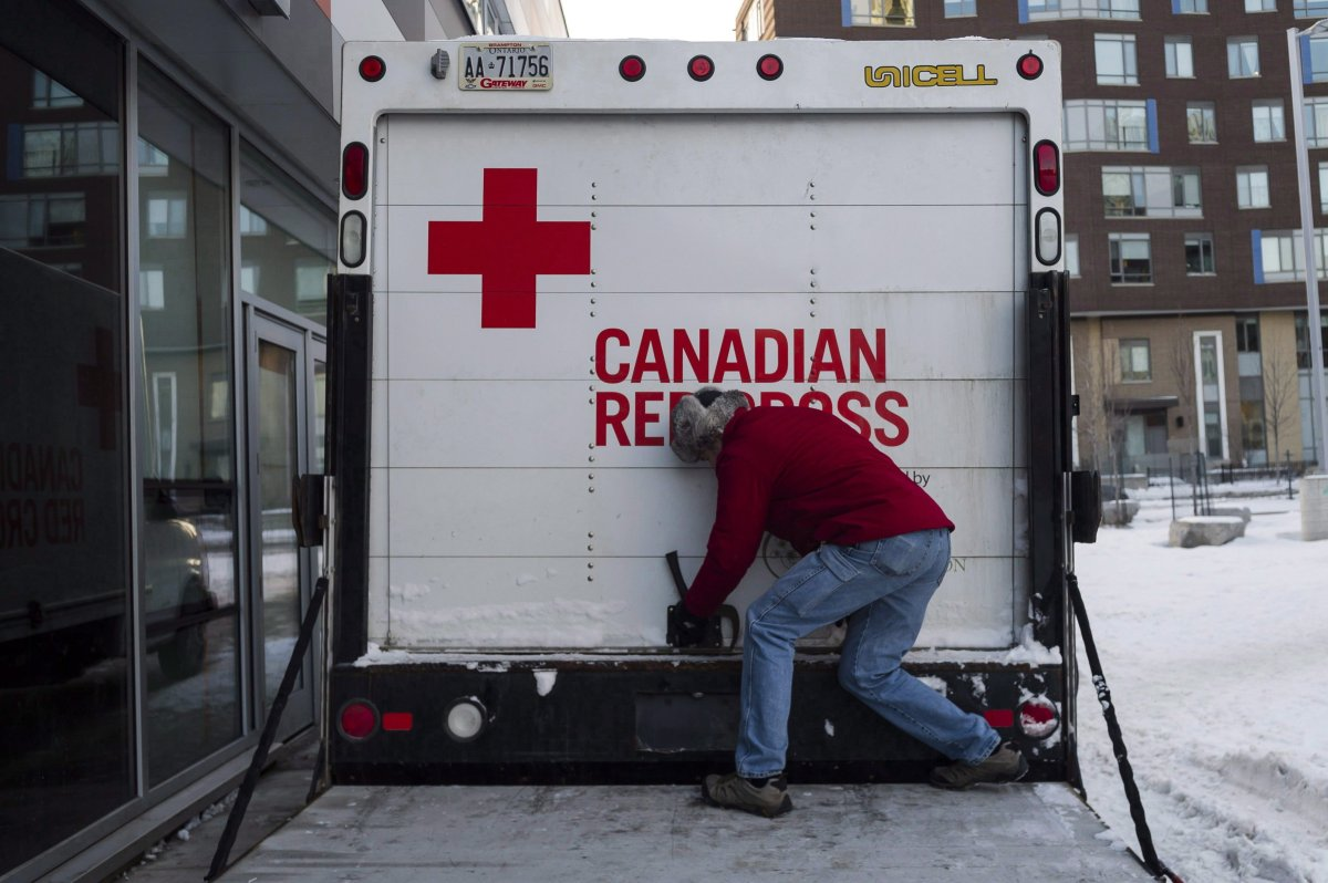 FILE: The Canadian Red Cross checks the contents of an emergency shelter unit.
