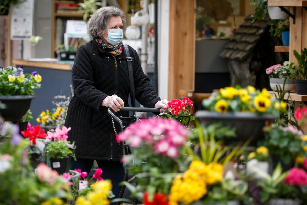 A customer shops at Golden Acre Home and Garden in Calgary, Alta., on Tuesday, April 14, 2020, amid the COVID-19 pandemic.