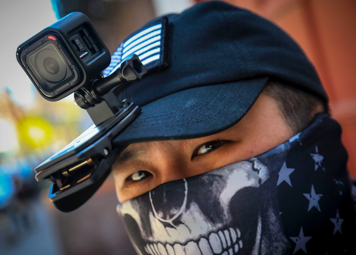 Eddie Song a Korean American entrepreneur, arrives at his motorcycle storage garage wearing a video camera clipped to his cap and a face mask due to COVID-19, Sunday April 19, 2020, in East Village neighborhood of New York.
