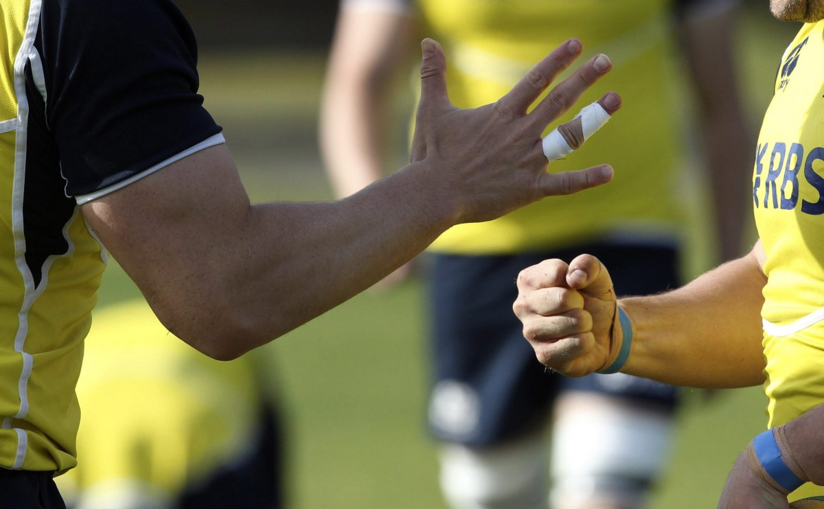 Two rugby players play rock paper scissors during training for their June 5 rugby test match against Australia, in Sydney Friday, June 1, 2012.