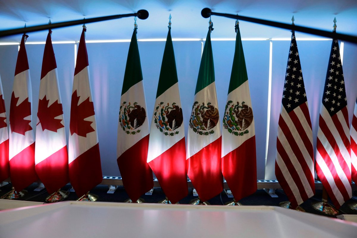 National flags representing Canada, Mexico, and the U.S. are lit by stage lights at the North American Free Trade Agreement, NAFTA, renegotiations, in Mexico City, Tuesday, Sept. 5, 2017.