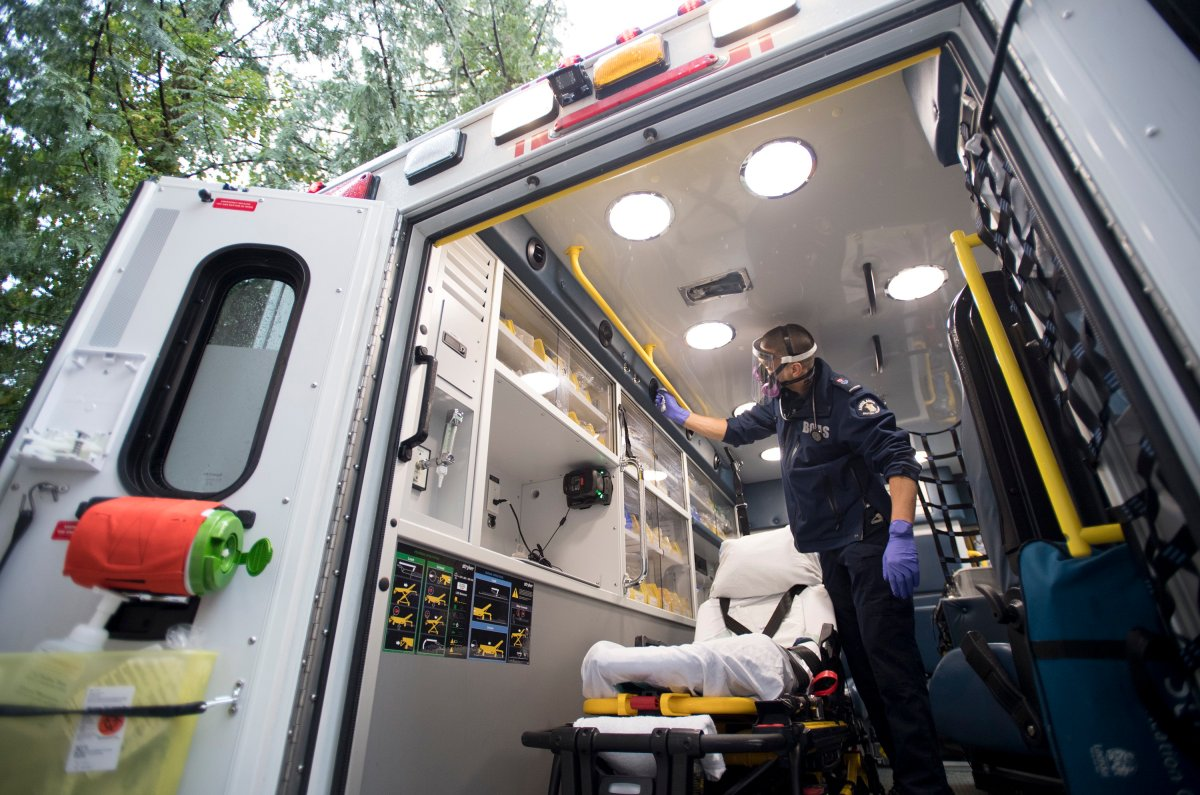 B.C. Ambulance paramedic Jeff Booton cleans his ambulance at station 233 in Lions Bay, B.C. Wednesday, April 22, 2020.