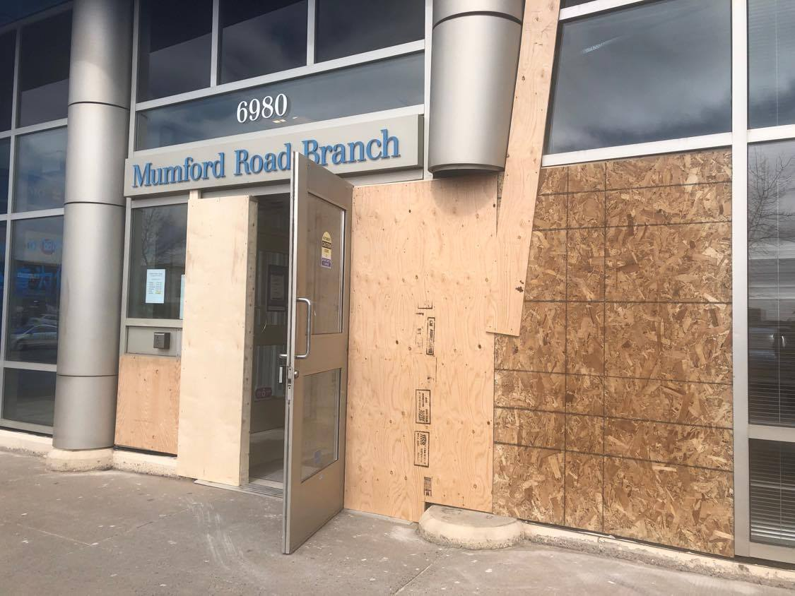 Police say a man has been charged after the car he was driving smashed into a BMO branch in Halifax causing significant damage to the business and the vehicle. .