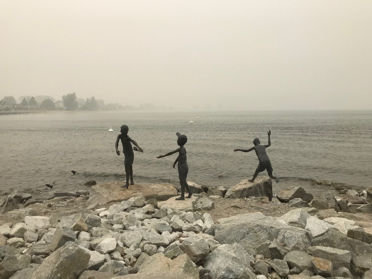 A statue of children playing is seen amid haze in Penticton on Sept. 14.