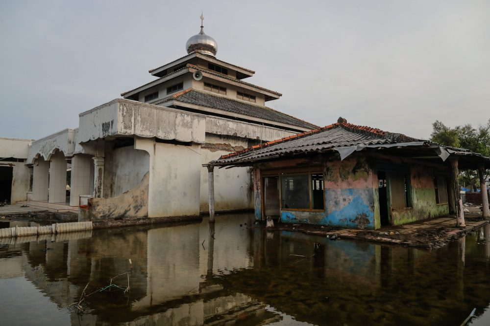 In this file photo, an abandoned house is shown in Pantai Bahagia village in Bekasi, West Java, Indonesia, on Dec. 3, 2019.