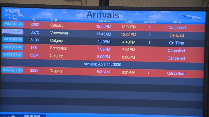"""The """"arrivals"""" display at Regina International Airport shows multiple cancelled flights on April 10, 2020."""