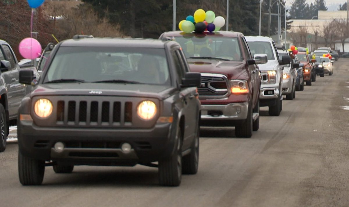 Calgarians in vehicles wished kids happy birthdays as they paraded through their neighbourhoods on Sunday, April 5, 2020.