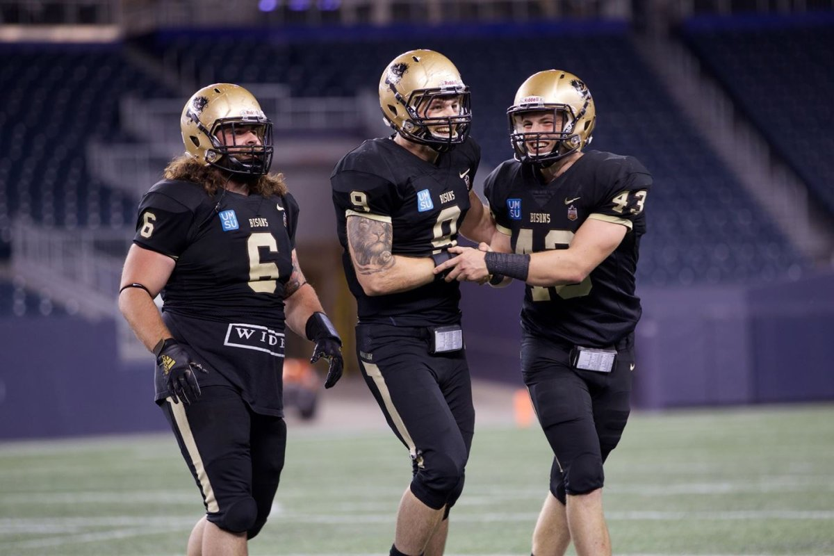 U of M Bison DL Brock Gowanlock {center) could be the first Defensive player out of Canada West to be selected in tonight's CFL draft. Photo supplied by Bison Sports.