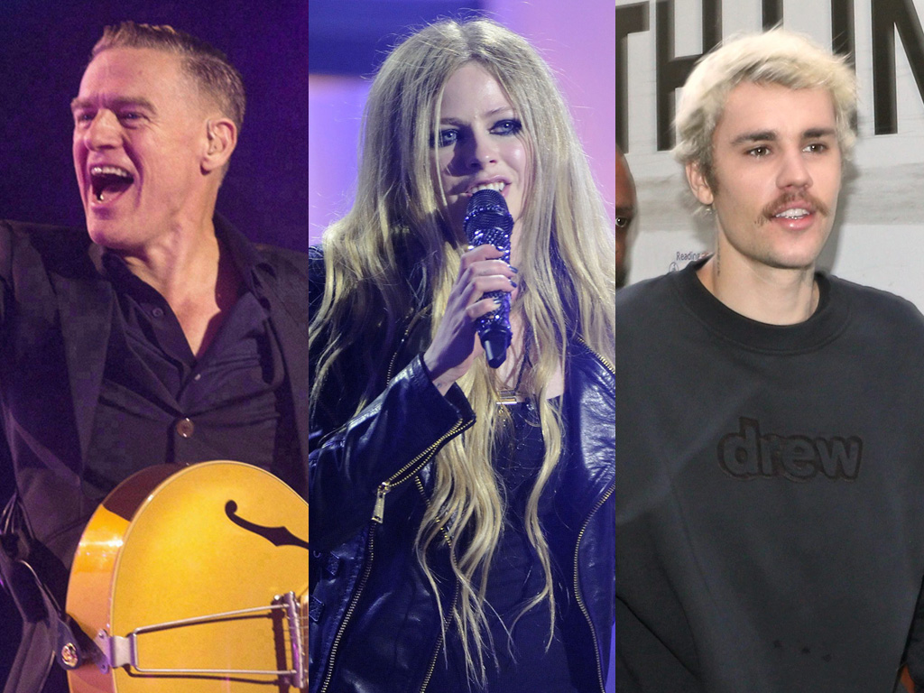 (L-R) Canadian musicians Bryan Adams, Avril Lavigne and Justin Bieber.