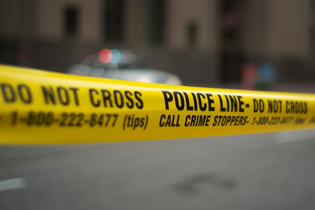 Police tape is shown in Toronto, Tuesday, May 2, 2107. THE CANADIAN PRESS/Graeme Roy.