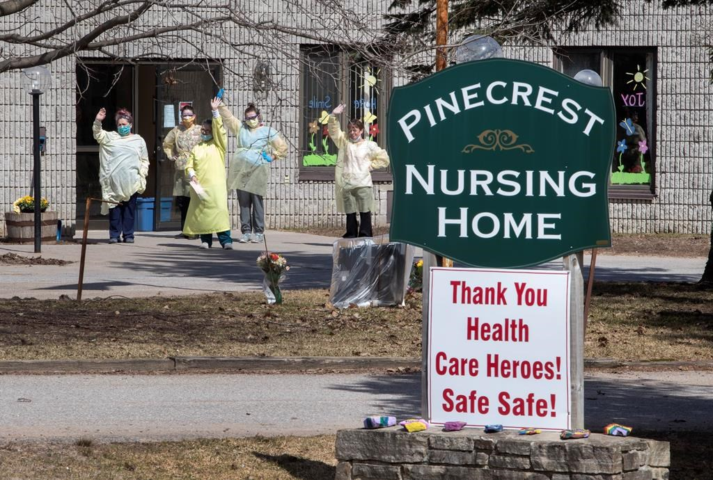 Nurses wave to hundreds of residents driving by Pinecrest Nursing Home honking their horns to acknowledge health-care workers in Bobcaygeon, Ontario on Wednesday April 1, 2020.