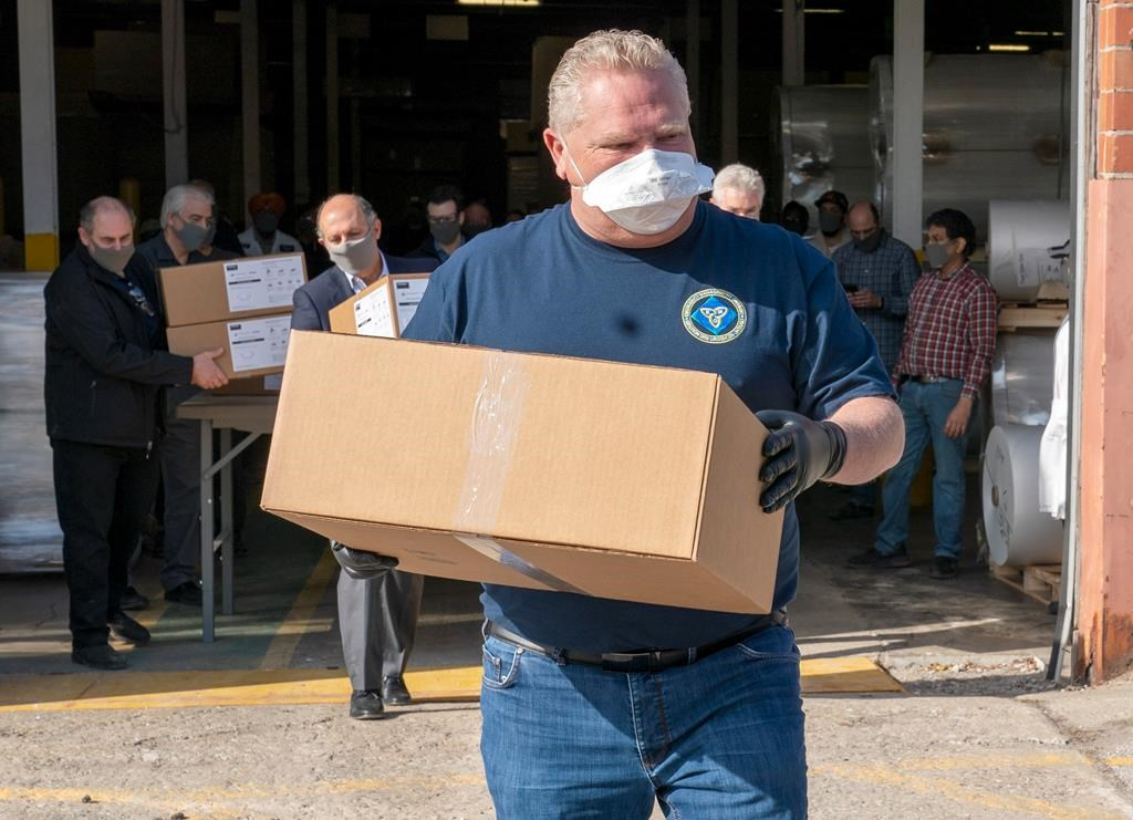 Approval ratings for Canadian politicians, such as Ontario Premier Doug Ford, pictured here helping unload a shipment of medical masks, have soared in the coronavirus crisis. But pollster Darrell Bricker isn't sure those high ratings will last.