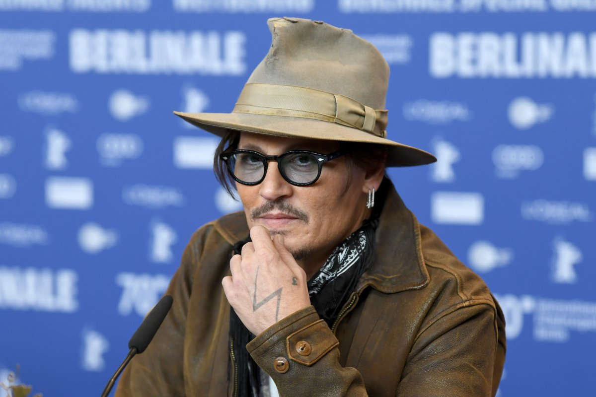 Actor Johnny Depp attends the press conference for Minamata during the 70th Berlin International Film Festival at the Grand Hyatt Berlin.