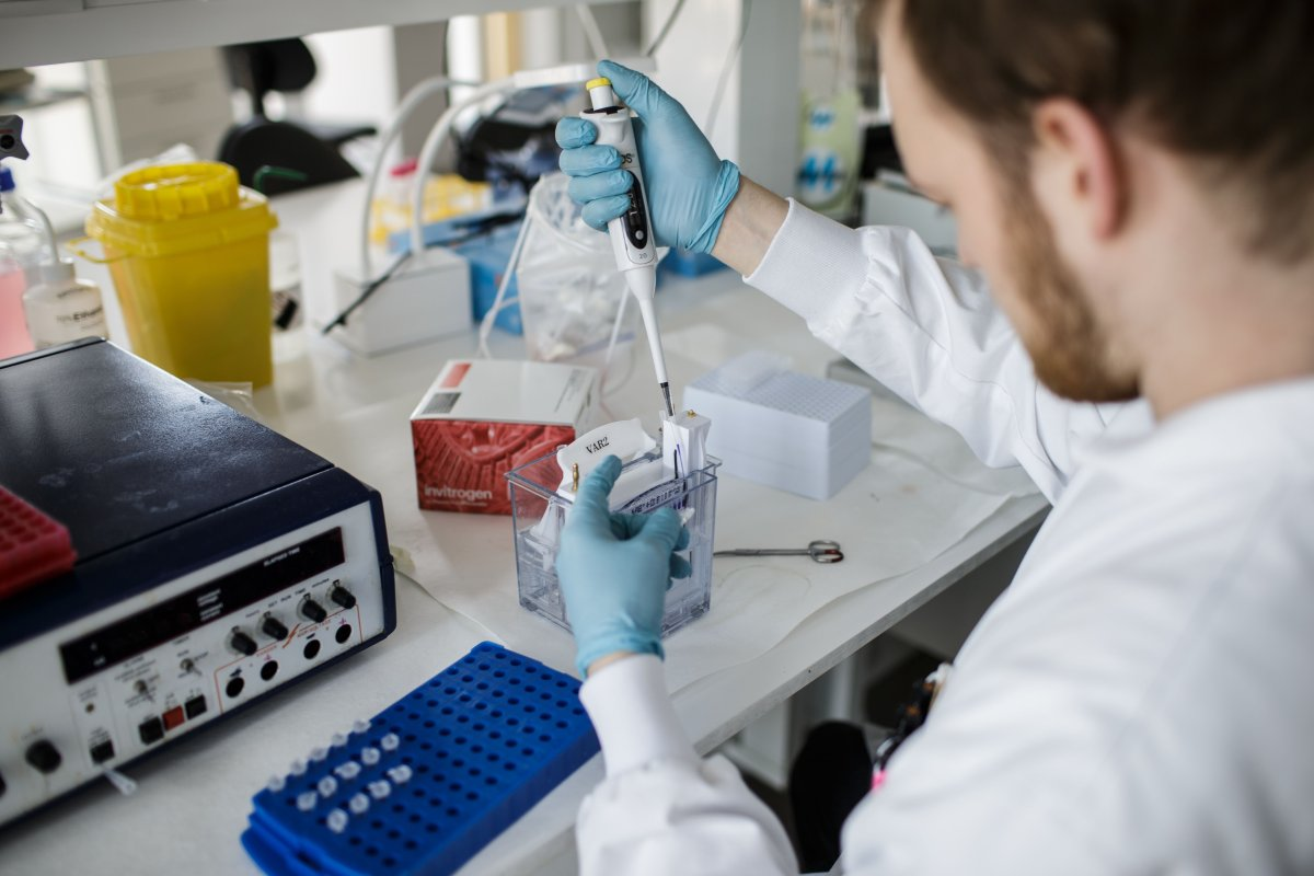 FILE: A researcher works on a vaccine against the new coronavirus COVID-19 at the Copenhagen's University research lab in Copenhagen, Denmark, on March 23, 2020.
