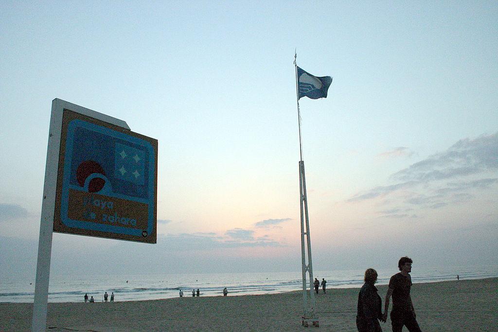 Zahara de los Atunes, Cadiz (Andalusia, Spain). EU (European Union) Blue Flag waving in the sunset at Zahara beach.