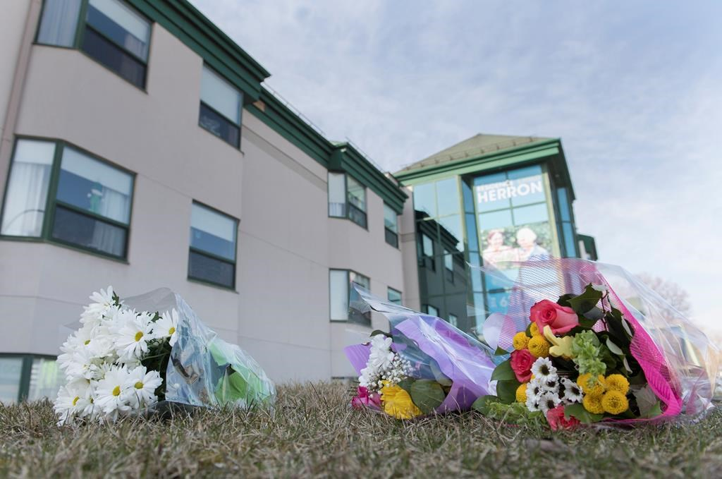Flowers are shown outside Maison Herron, a long term care home in the Montreal suburb of Dorval, Sunday, April 12, 2020, as COVID-19 cases rise in Canada and around the world. THE CANADIAN PRESS/Graham Hughes.